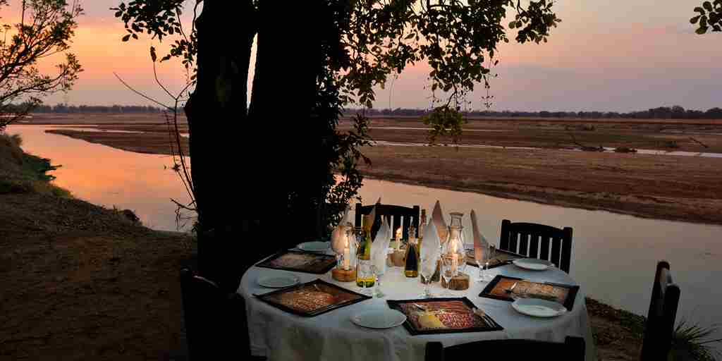 RAS - TAFIKA - DINNER OVERLOOKING THE RIVER.jpg