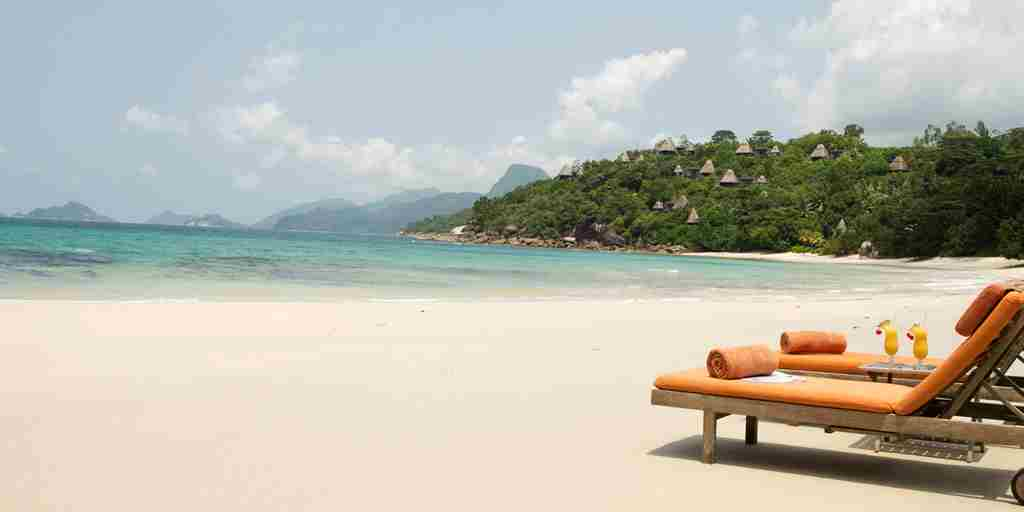 Maia Luxury Resort & Spa - Beach With Deck Chairs.jpg