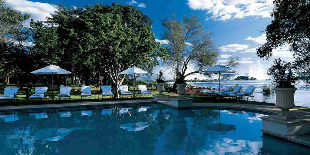 Pool area with the Victoria Falls in the background The Royal Livingstone.jpg
