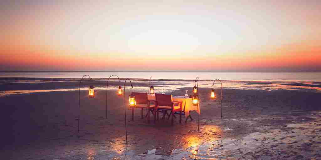Azura Benguerra dining on beach setup 2