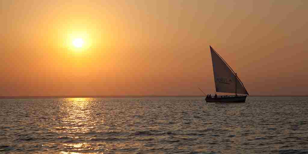 Azura Benguerra Sunset with dhow sailing landscape