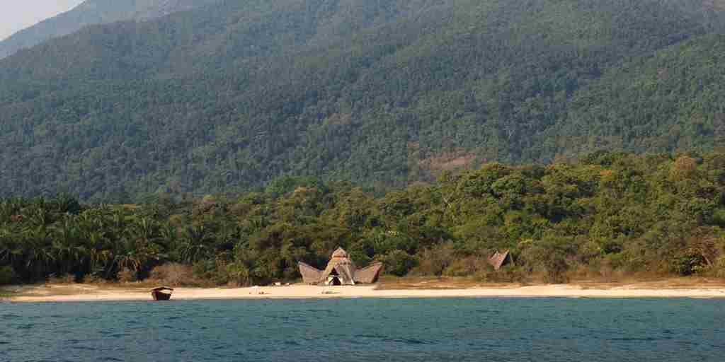 Greystoke Mahale beach with mountains - Nomad Tanzania.jpg