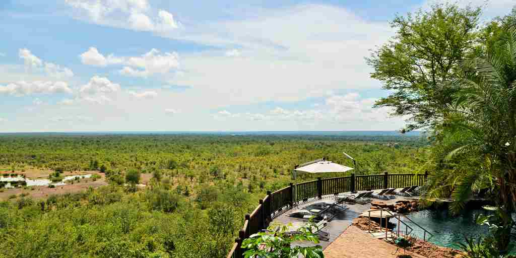 Swimming Pool and waterhole at Victoria Falls Safari Lodge.JPG