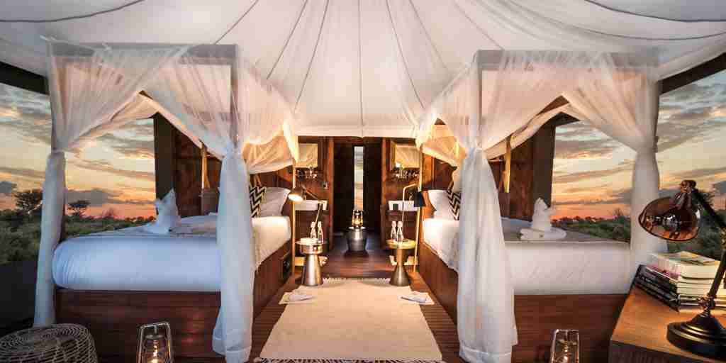 TENTED SUITE - two beds view through windows.jpg