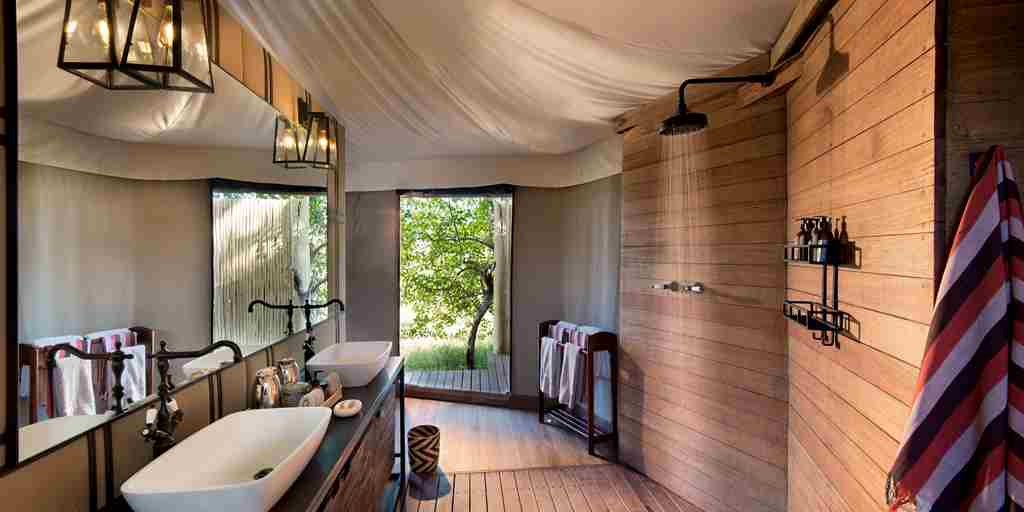 andBeyond-Nxabega-Okavango-Tented-Camp-Ensuite-Bathroom1.jpg