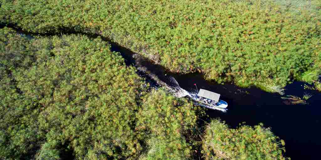 andBeyond-Nxabega-Okavango-Tented-Camp-Boating-Aerial.jpg