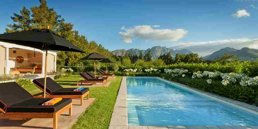 12. LA CLÉ DES MONTAGNES - Le Colonial lounging by the pool.jpg
