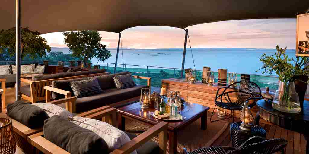 bumi_hills_safari_lodge_lake_kariba_zimbabwe_luxury_safari_lodge__kingfisher_cottage_double_suite_living_room_lake_view_african_bush_camps_32.jpg