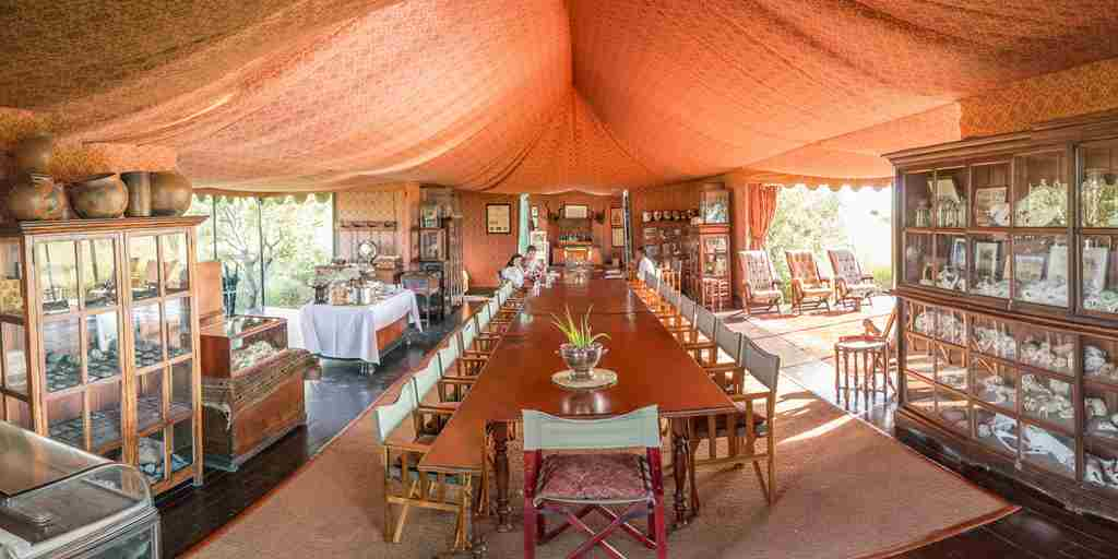 Jack's Camp, Botswana - Dining room & piano.jpg