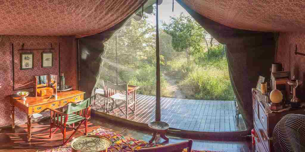 Jack's Camp, Botswana - Bedroom & view from interior.jpg