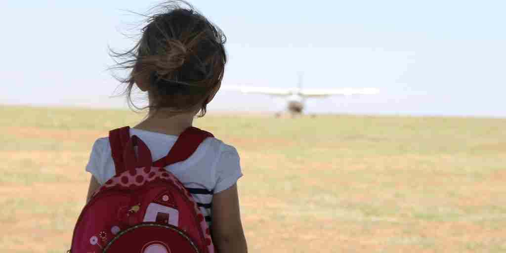 Family-experience-young-girl-watching-plane-arrive.jpg