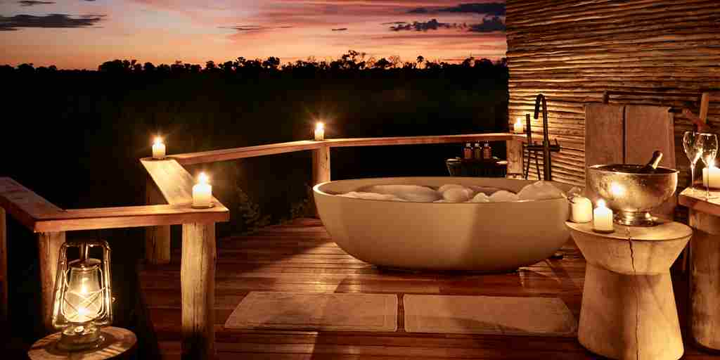 outdoor bathroom sanctuary baines camp moremi botswana yellow zebra safaris