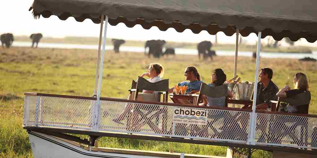 &Beyond-Chobe-Under-Canvas-sunset-boating.jpg