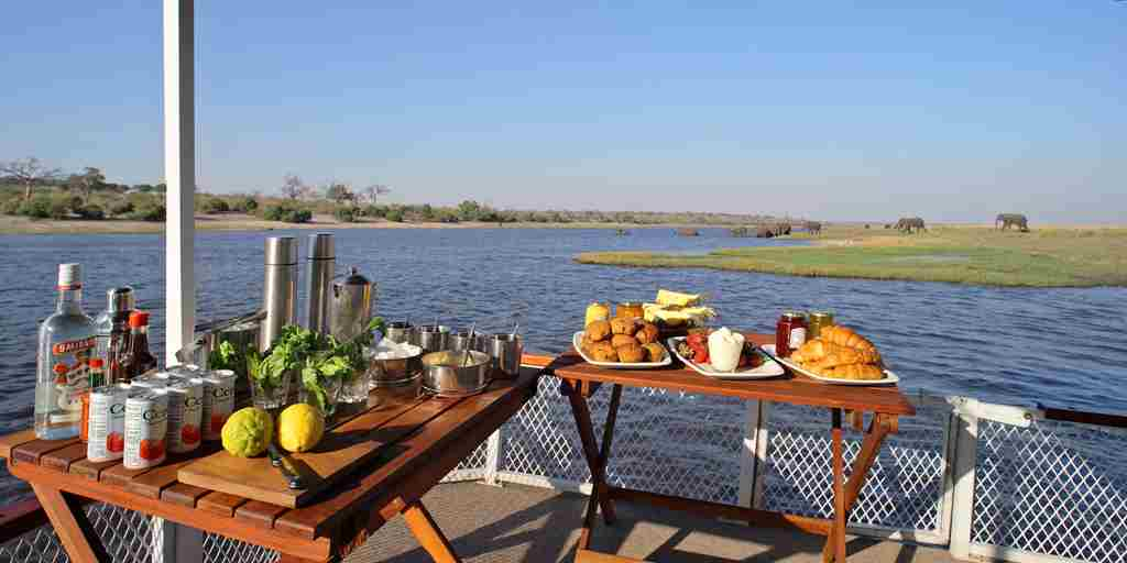 &Beyond-Chobe-Under-Canvas-boating-food-alcohol.jpg