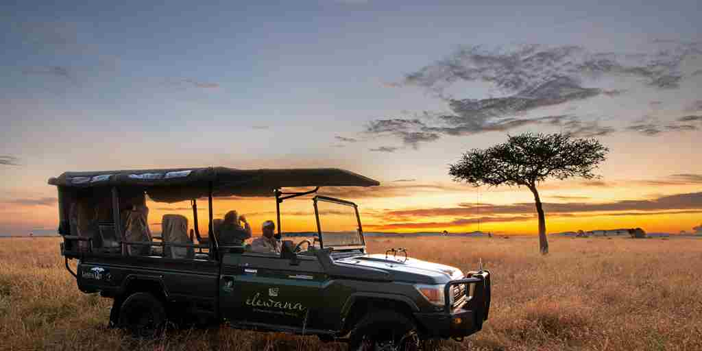 sand-rivers-tanzania-jeep-sunset.jpg