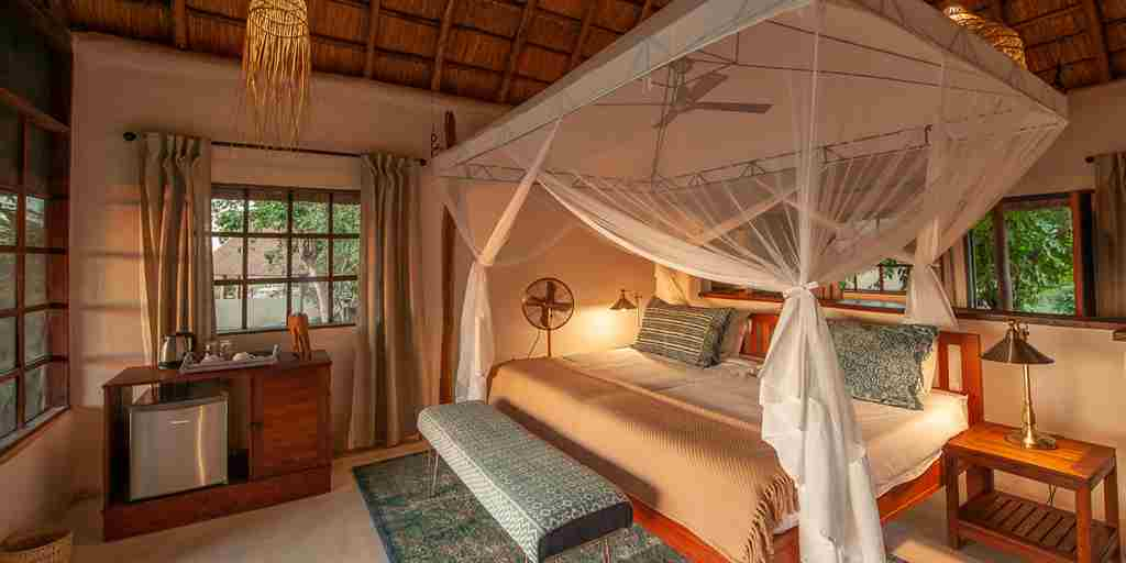 bed-standard-guestroom-kafunta-river-lodge-zambia-yellow-zebra-safaris.jpg