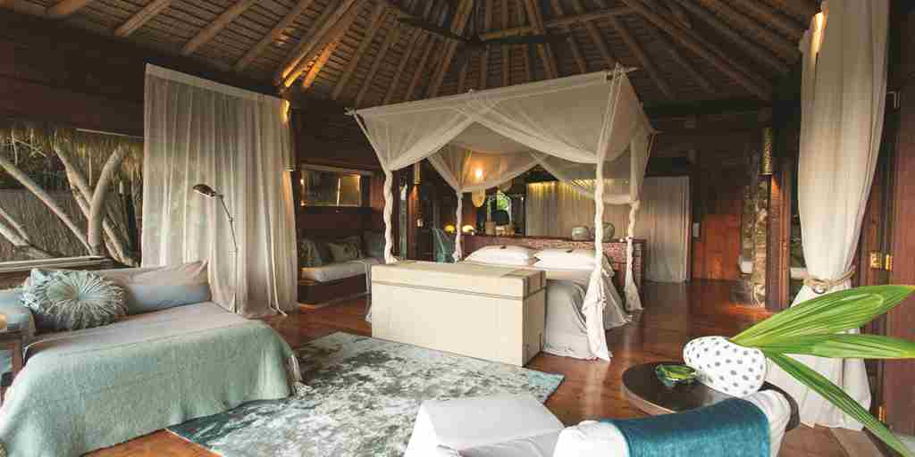 north-island-seychelles-bedroom-yellow-ebra-safaris.jpg