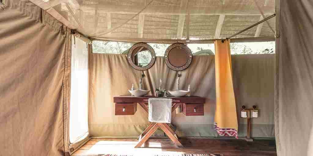 tent bathroom basecamp maasai mara kenya yellow zebra safaris