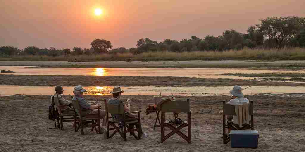 Mwaleshi Camp sundowners zambia yellow zebra safaris