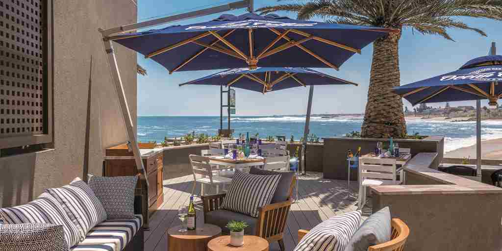 outdoor dining strand hotel swaokpmund namibia yellow zebra safaris