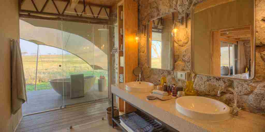 bathroom namiri plains tanzania yellow zebra safaris
