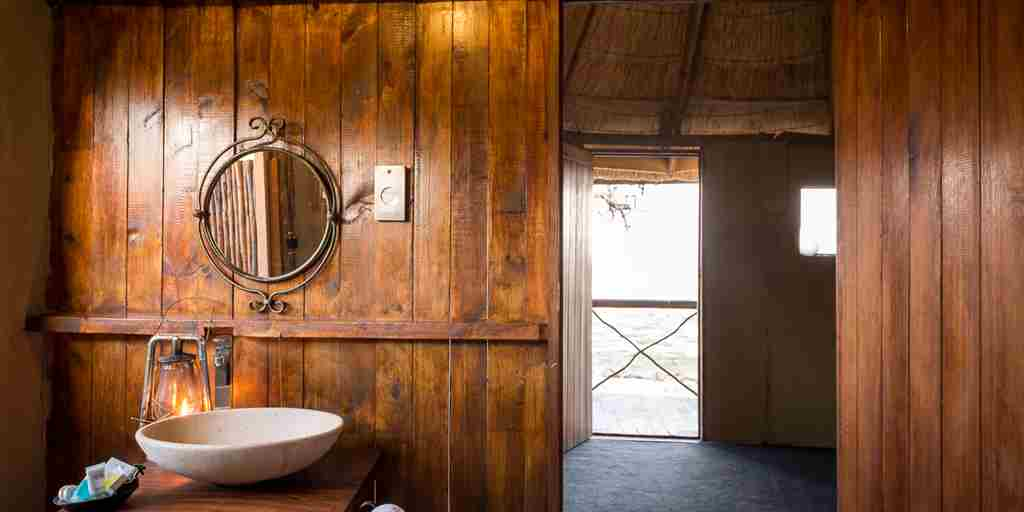 camp-linyanti-botswana-bathroom-yellow-zebra-safaris.jpg