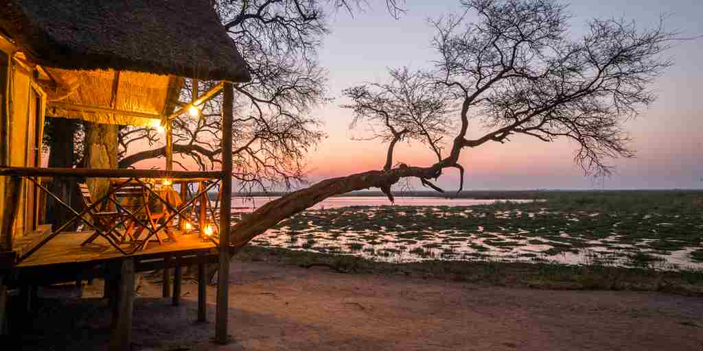 camp-linyanti-botswana-sunset-yellow-zebra-safaris.jpg