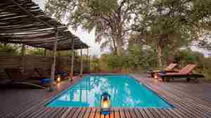 motswiri-camp-pool-deck-botswana-yellow-zebra-safaris.jpg