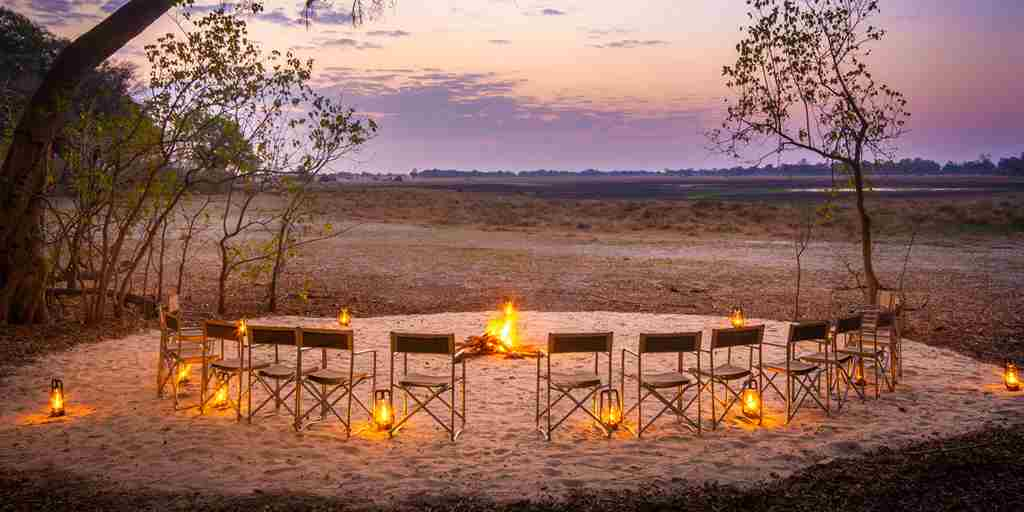 kwara-camp-fire-seating-botswana-yellow-zebra-safaris.jpg