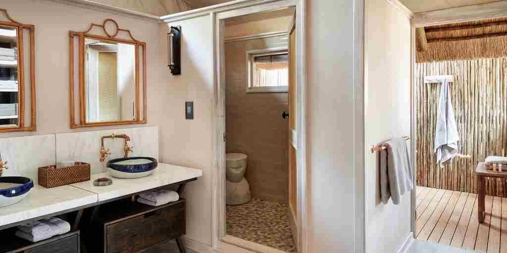 belmond savute elephant lodge botswana bathroom yellow zebra safaris