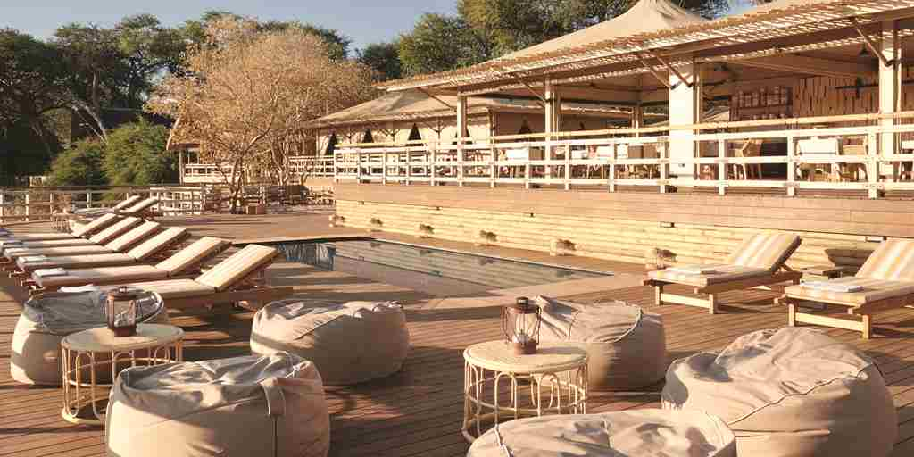 belmond savute elephant lodge pool deck yellow zebra safaris