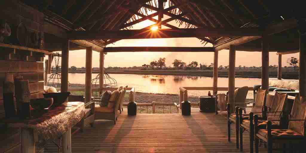 belmond eagle island lodge botswana sunset yellow zebra safaris
