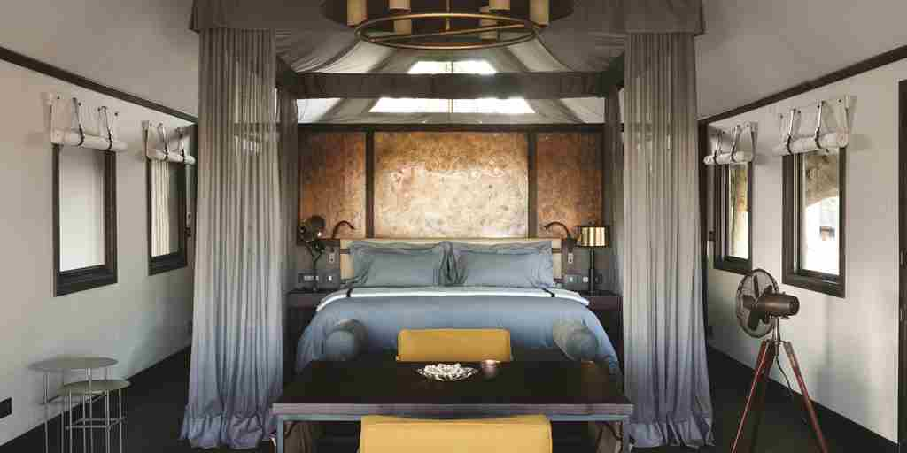 belmond eagle island lodge double bedroom botswana yellow zebra safaris