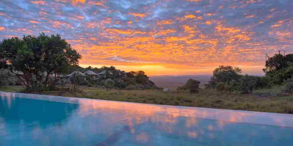 angama-mara-pool-sunset-kenya-yellow-zebra-safaris.jpg