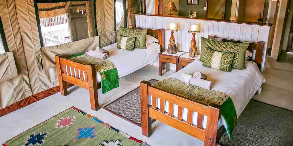 the-hide-safari-camp-twin-bedroom-zimbabwe-yellow-zebra-safaris.jpg