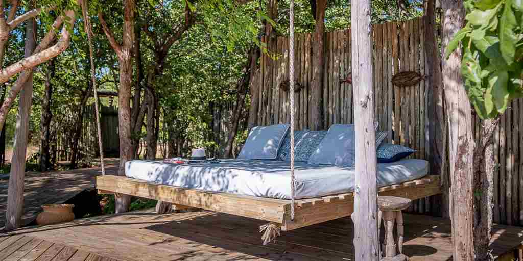 changa-safari-camp-swing-bed-zimbabwe-yellow-zebra-safaris.jpg