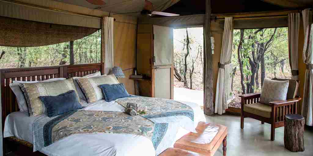 changa-safari-camp-bedroom-zimbabwe-yellow-zebra-safaris.jpg
