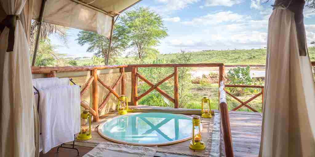 elephant-bedroom-camp-bedroom-pool-kenya-yellow-zebra-safaris.jpg