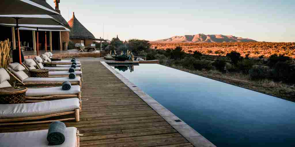 omaanda windhoek namibia pool decking yellow zebra safaris