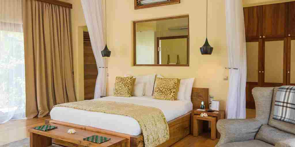 white sand villas luxury bedroom zanzibar tanzania yellow zebra safaris