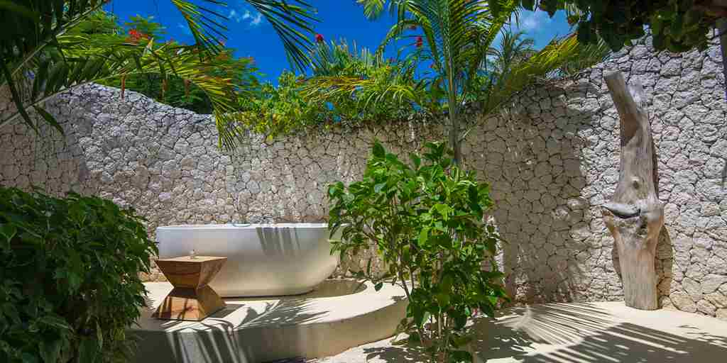 white sand villas outdoor bathtub zanzibar tanzania yellow zebra safaris