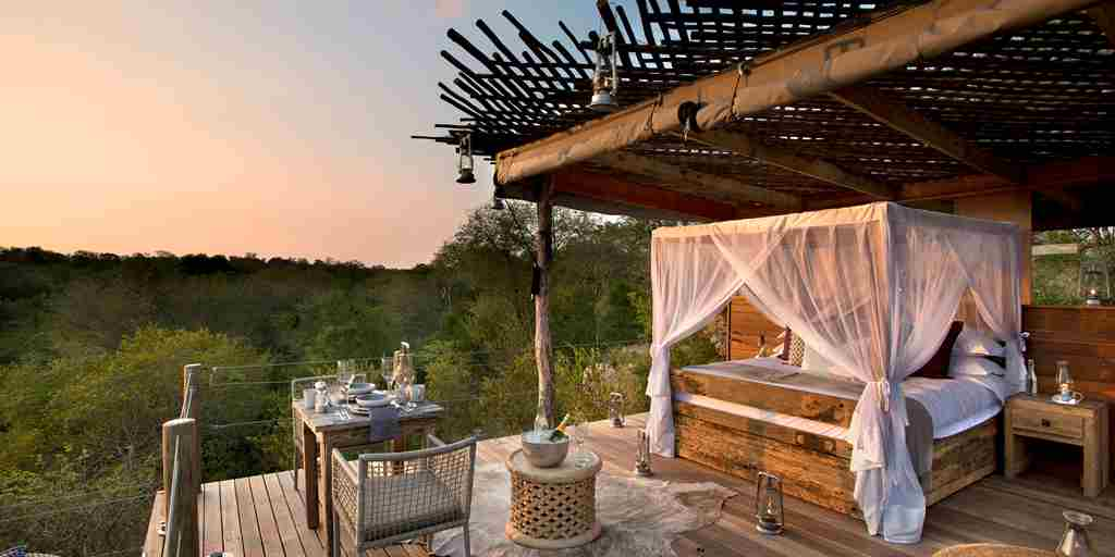 lion-sands-ivory-lodge-outside-bed-south-africa-yellow-zebra-safaris.jpg