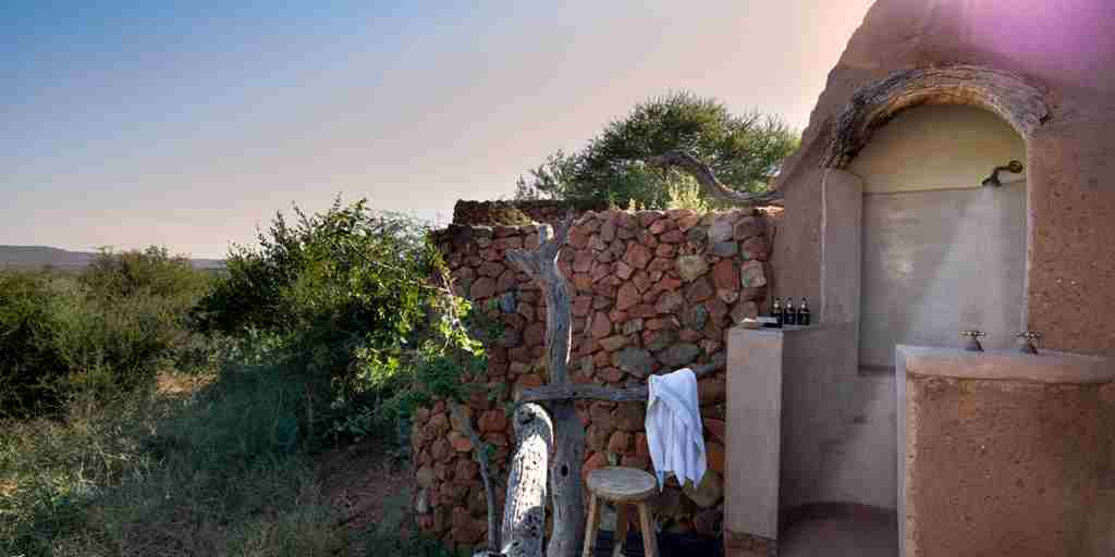 madikwe kopano lodge south africa shower yellow zebra safaris