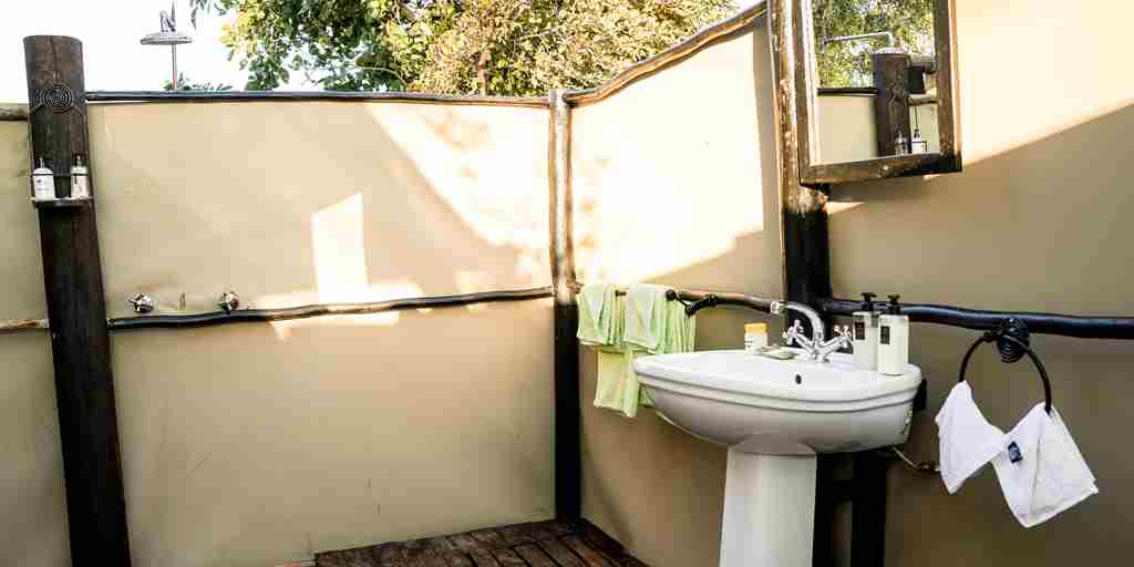 little-vundu-camp-bathroom-view-zimbabwe-yellow-zebra-safaris.jpg