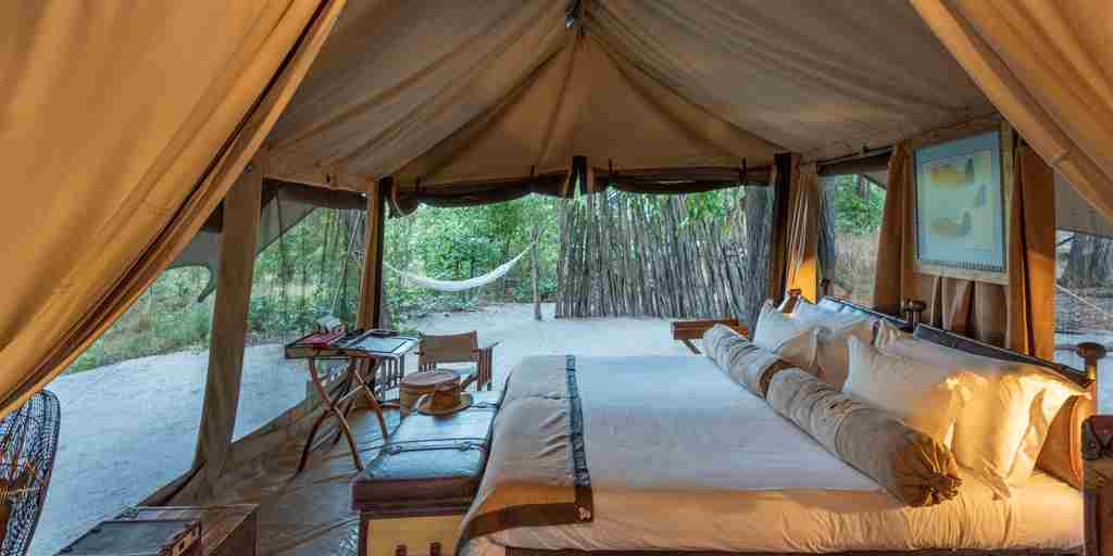 selinda explorers camp bedroom botswana yellow zebra safaris