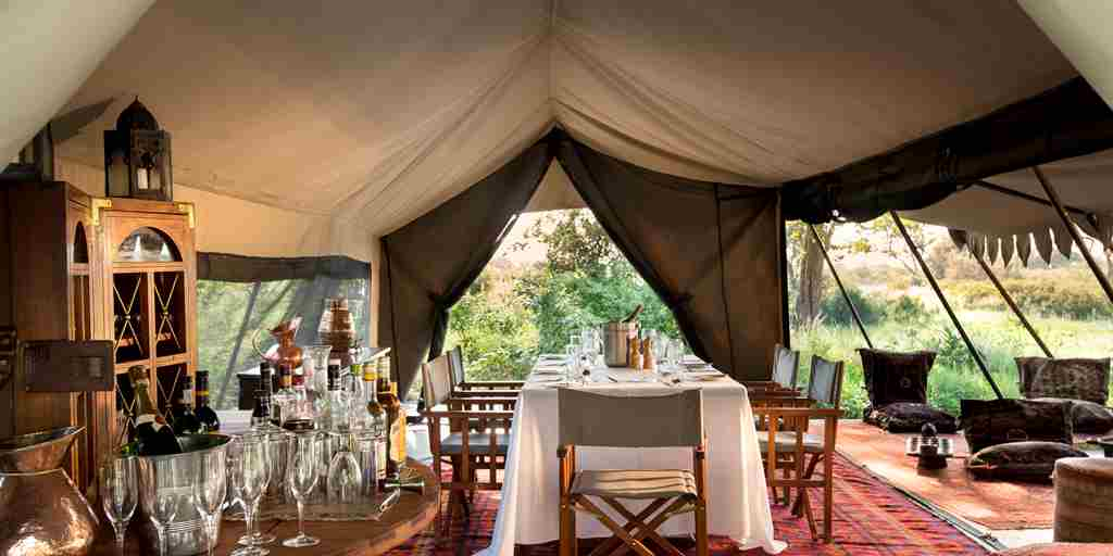selinda explorers camp dining botswana yellow zebra safaris