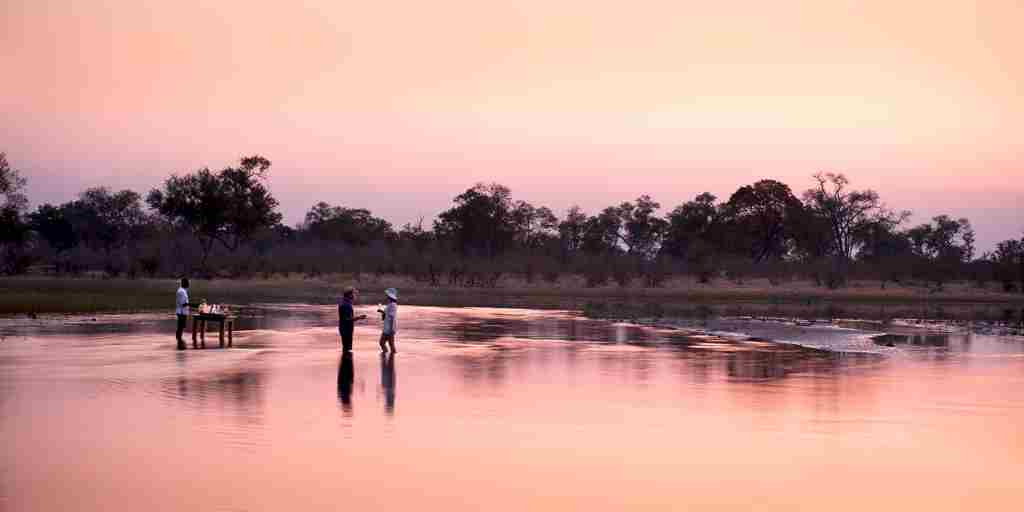 selinda explorers camp sun set botswana yellow zebra safaris