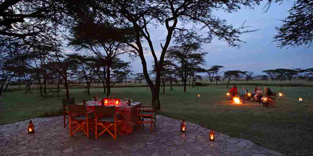 Topi-House-camp-fire-exterior-kenya-yellow-zebra-safaris.jpg