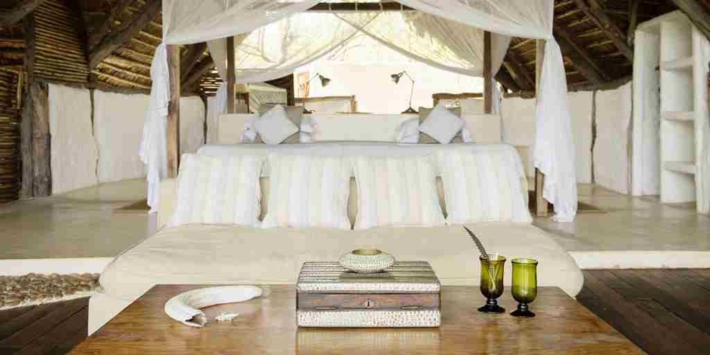 Sand-Rivers-Camp-Selous-double-bed-yellow-zebra-safaris.jpg