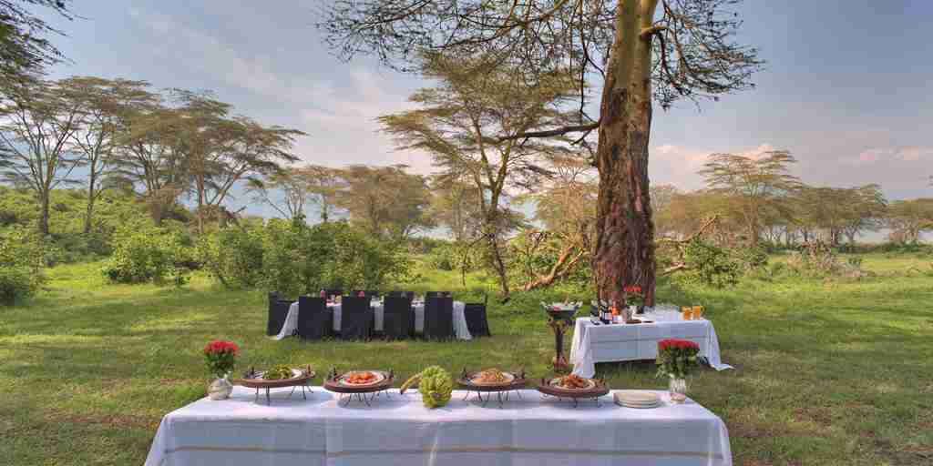 ngorongoro-crater-lodge-bush-dining-tanzania-yellow-zebra-safaris.jpg